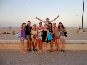 students after the lessons at an activity of our school at the beach