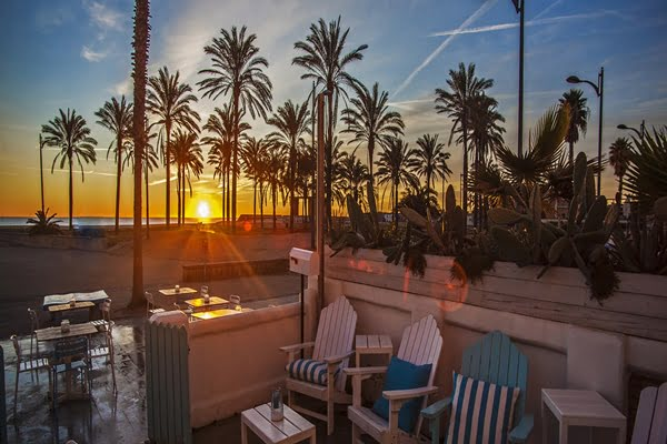 hotel in front of the beach with the sunset